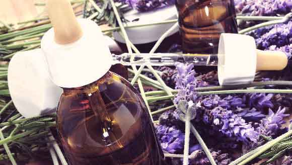 A Bottle of Liquid With Lavendar And Other Homeopathic Ingredients