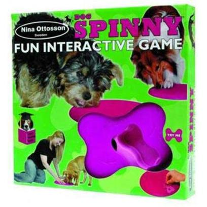 "The Company of Animals Presents Dog Spinny Treat Search Game Spinny-Interactive. Renowned Swedish Animal Behaviorist Nina Ottosson is the Creator and Designer of the Original Interactive Pet Puzzle Games. Her Games are Distributed Exclusively in the U.S. By the Company of Animals. The ""Dog Spinny"" has a Single Removable Bone that has to be Dislodged by the Dog, who can then Rotate the Top Section to Access Treats in the Compartments Below. By Gradually Reducing the Number of Treats, you can Encourage your Pet to Work Harder. Made of Strong Plastic for Durability and Ease of Cleaning. [20224]"